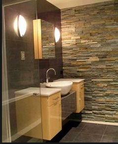 floating vanity with stone wall